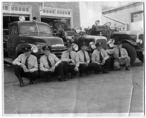 Primary view of object titled '[Fire Chief John Ballew with Firemen 1948]'.