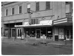 Primary view of object titled '[Harp Drugs on Main Street]'.