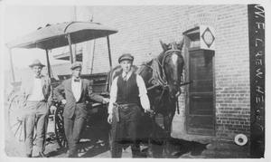 Primary view of object titled '[Men With Wells Fargo Wagon]'.