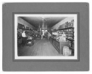 Primary view of object titled 'City Grocery-J.T. Sparkman at back S.B. Partain at cash reg'.