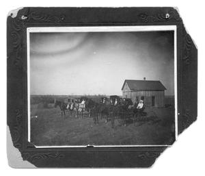 Primary view of object titled '[A group of horse-drawn vehicles]'.