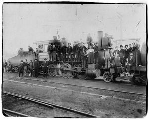Primary view of object titled '[Railroad Office Employees on and around a Steam Engine in the Shop Yards]'.