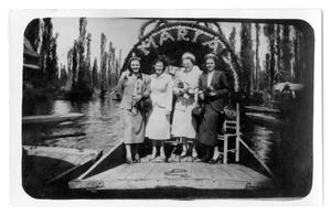Marie Burkhalter, Harvest Queen, and Vivian Osio standing on a river boat