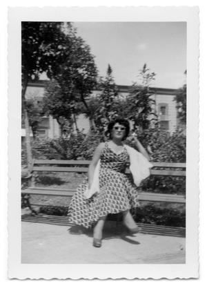 Primary view of object titled '[Lola Berber sitting on a bench]'.