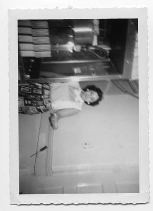 Primary view of object titled 'Unidentified woman standing in a passageway'.