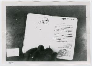 Primary view of object titled '[Lee Harvey Oswald's Passport, Photograph #7]'.
