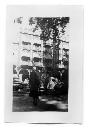Primary view of object titled 'Vivian Osio standing in front of an hotel'.