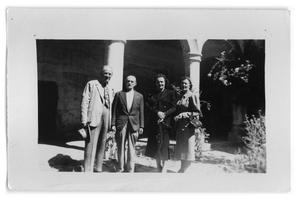 Primary view of object titled 'Marie Burkhalter and Vivian Osio with two unknown men.'.