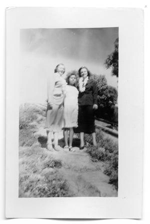 Primary view of object titled 'Marie Burkhalter and with two unknown people'.