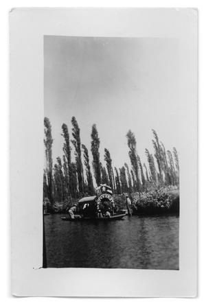 Primary view of object titled '[A river boat carrying passengers on a river]'.