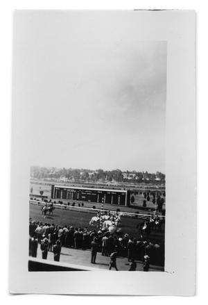 Primary view of object titled 'People riding their horses on a race track'.