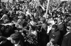 Primary view of object titled '[President and Mrs. Kennedy greeting crowds at Love Field]'.
