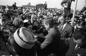 [The Kennedys greeting the crowd at Love Field]