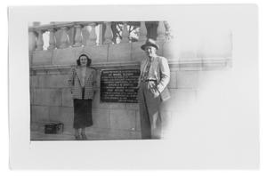 Primary view of object titled 'Unidentified woman and man standing next to a wall'.