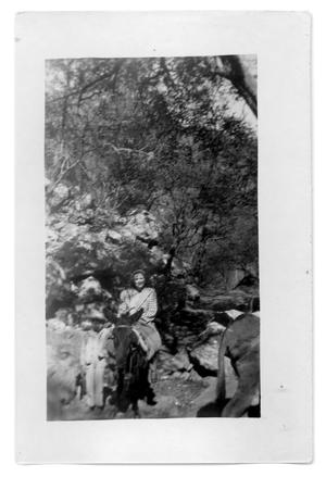 Primary view of object titled 'Unidentified woman riding a mule'.