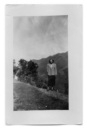 Primary view of object titled '[Photograph of Woman Standing on Hill]'.