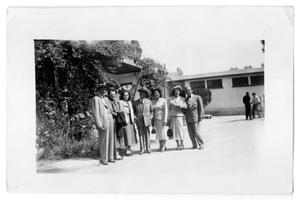 Primary view of object titled 'Group of people outside a building'.