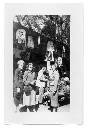 Primary view of object titled 'Women and a man outside a store'.