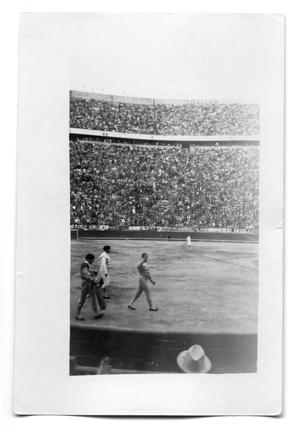 Primary view of object titled 'Bull fighters walking in an arena'.