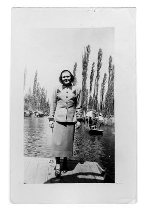 Primary view of object titled 'Woman stands on a dock'.