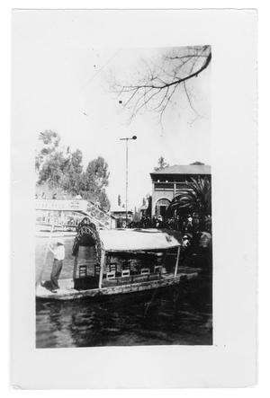Primary view of object titled 'River boat departing from shore'.