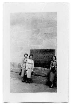 Primary view of object titled 'Three women in front of a stone building'.