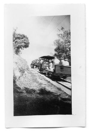 Primary view of object titled 'People on a rail car'.