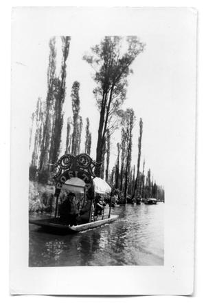 Primary view of object titled 'People in a river boat'.