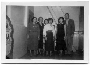 Primary view of object titled 'Five women and a man standing in the back of a corridor'.