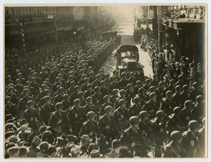 Primary view of object titled '[Photograph of Military Parade Through Town]'.