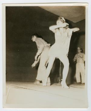 Primary view of object titled '[Photograph of Chuck Allen and a Dancing Woman]'.