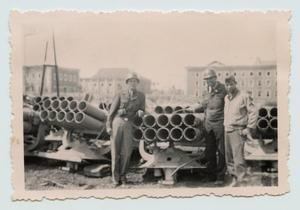 Primary view of object titled '[Men Standing with Captured Mounted Rocket Launchers]'.