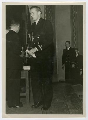 Primary view of object titled '[Photograph of Ernest Wilemon Receiving Naval Commission]'.