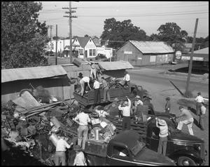 Primary view of object titled '[Workers Unloading Scrap Metal]'.