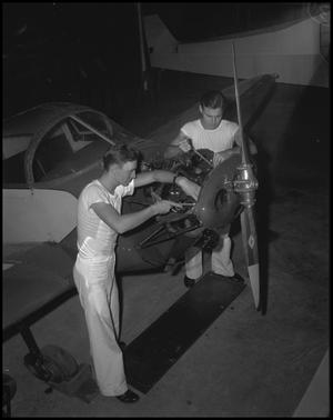 Primary view of object titled '[In the Plane Repair Shop]'.