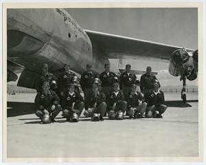 Primary view of object titled '[Photograph of Airmen in Front of Aircraft]'.