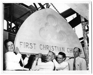 [Carrying the First Christian Church Entrance Tablet]