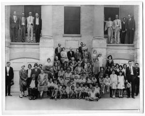 Primary view of object titled '[Men, Women, and Children on the Steps of the First Christian Church in Port Arthur, Texas]'.