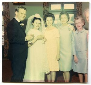 Primary view of object titled '[Tom and Joann Kearn on their wedding day with Betty Scrivner and Helen Dickson]'.