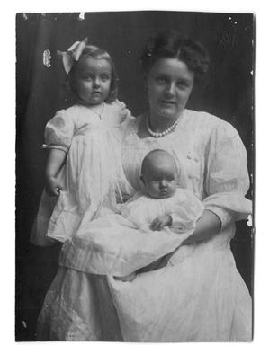Primary view of object titled '[Carolyn Scott with two children]'.