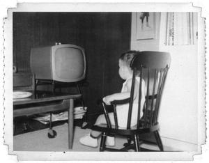 Ray Delphenis watching television
