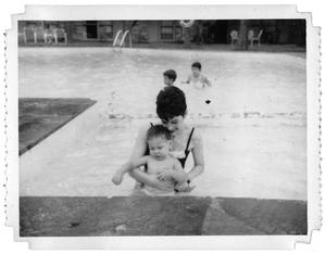 Primary view of object titled 'Ray Delphenis and Durk Delphenis in a pool at the Lakewood County Club'.