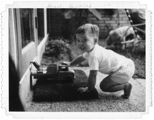 Primary view of object titled 'Ray Delphenis playing with a toy'.