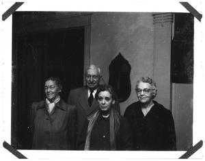 Primary view of object titled 'Group of people in an unknown room'.