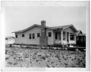 Primary view of object titled 'Corner view of single-story house'.
