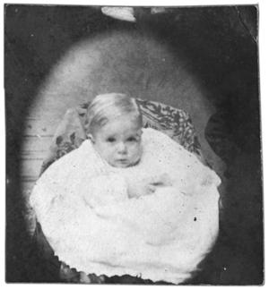 Portrait of a baby in a dress