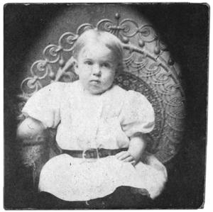 Primary view of object titled 'Portrait of a child in a white outfit'.