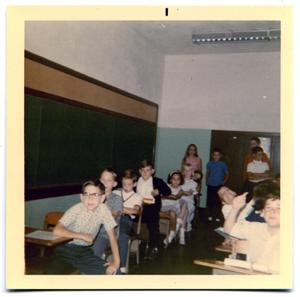 Primary view of object titled 'Students sitting in a classroom'.