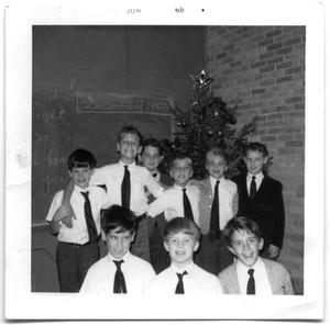 Primary view of object titled 'Group of school boys standing in the corner of a classroom'.