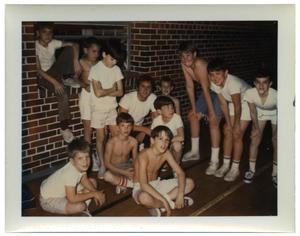 Primary view of object titled 'Group of boys next to a brick wall'.